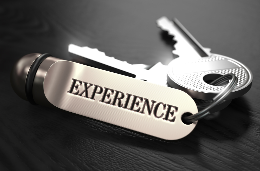 Experience Concept. Keys with Keyring on Black Wooden Table. Closeup View, Selective Focus, 3D Render. Black and White Image.