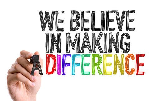 Hand with marker writing We Believe in Making a Difference-1