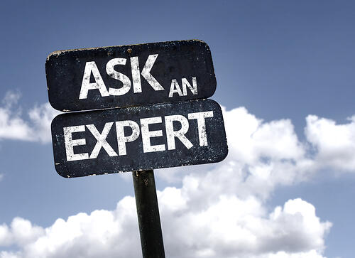 Ask An Expert sign with clouds and sky background