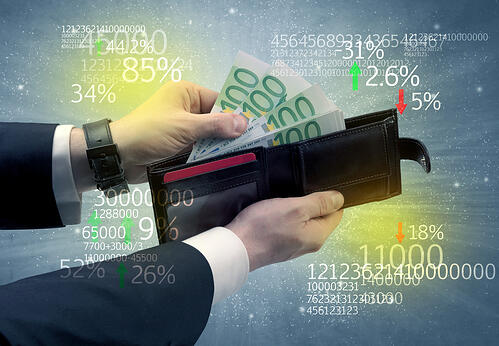Businessman and takes out euro from wallet with stock exchange theme