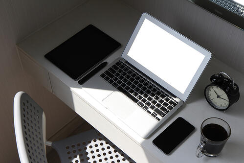 blank screen laptop computer and smart phone and digital tablet and stylus pen is on wooden desk as workplace concept
