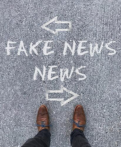 person_standing_on_a_ground_with_fake_news_and_news_-scopio-b97b3255-1681-4775-bbde-baaa2b13a031-1